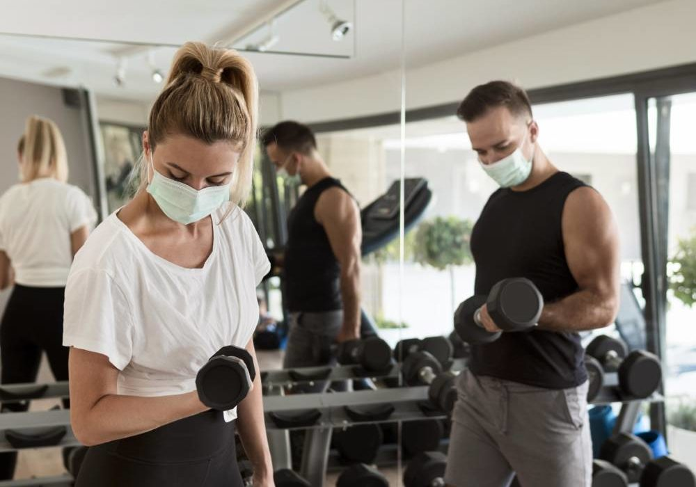 man-and-woman-working-out-together-at-the-gym